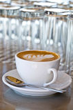 Cup of coffee. Coffee with foam pattern Royalty Free Stock Photography