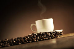 Cup of coffee. On the wooden table royalty free stock photos