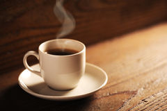 Cup of coffee. On the wooden table royalty free stock images