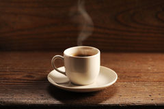 Cup of coffee. On the wooden table stock photos