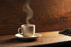 Cup of coffee. On the wooden table royalty free stock photography