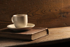 Cup of coffee. And old books royalty free stock photography