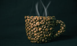 Cup of coffee. On a black background Royalty Free Stock Images