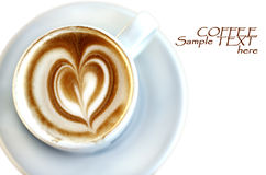 Cup of coffee. With a heart of foam Stock Photos