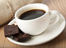 Cup of coffee. And chocolate on a dark background Royalty Free Stock Photo