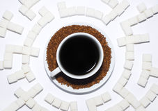Cup of coffee. In the middle of a labyrinth from cubes of the refined sugar Royalty Free Stock Image