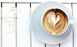 Cup of coffee. On white table Stock Photography