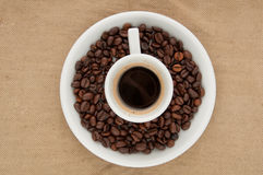 A cup of coffee. A cup of coffee on the background of coffee beans Stock Images
