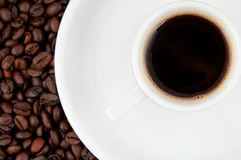A cup of coffee. A cup of coffee on the background of coffee beans Royalty Free Stock Photo