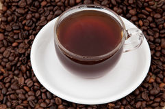 A cup of coffee. A cup of coffee on the background of coffee beans Stock Photo
