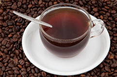 A cup of coffee. A cup of coffee on the background of coffee beans Stock Photography