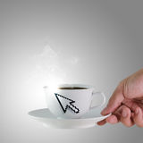 Cup of coffee. Hand holds a cup of coffee with arrow cursor sign Stock Images