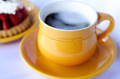 Cup of coffee. And strawberry cake royalty free stock images