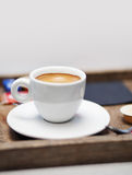 Cup of coffee. Served on a wooden tray Royalty Free Stock Image