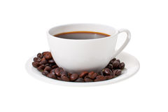 Cup of coffee. On a saucer, around coffee grains Royalty Free Stock Image