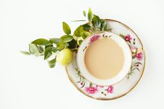 A cup of coffee. Beautiful vintage cup full of coffee with little apples Stock Image