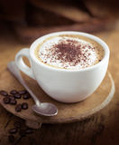 Cup of coffee. Hot cup of coffee with spoon on table Royalty Free Stock Photography