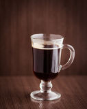 Cup of coffee. Coffee cup on the brown board Stock Images