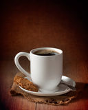 Cup Of Coffee. With biscuits on burlap mat Royalty Free Stock Image