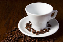 A cup of coffee. And coffee beans Stock Images