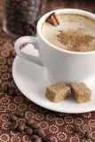 Cup of coffee. With cinnamon and sugar royalty free stock photo