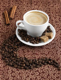 Cup of coffee. With cinnamon and sugar royalty free stock photos