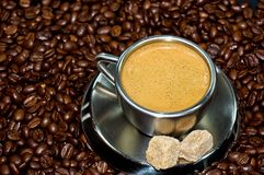 Cup of coffee. In a pile of coffee beans Royalty Free Stock Photos