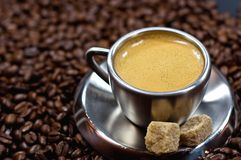 Cup of coffee. In a pile of coffee beans Royalty Free Stock Photo