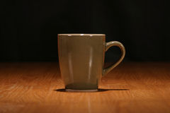 Cup of Coffee. On a wooden table Stock Photos
