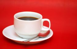 Cup of coffee. On red background Royalty Free Stock Photos