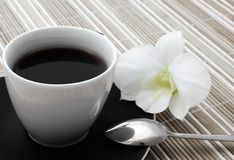 Cup of coffee. Cup of black morning coffee with flower Royalty Free Stock Photography
