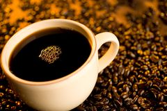 Cup of Coffee. Cup of black coffee in coffee beans Stock Images