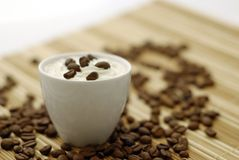 Cup of coffee. With beans Royalty Free Stock Photography