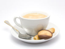 Cup of Coffee. On a suacer with some cookies and a silver spoon royalty free stock photo