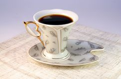 A cup of coffee. Elegant porcelain cup with black coffee Stock Photos