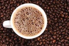 Cup of coffee. On beans background Royalty Free Stock Photos
