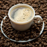 A cup of coffee. With coffee beans Stock Photography