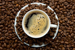 A cup of coffee. With coffee beans Royalty Free Stock Images