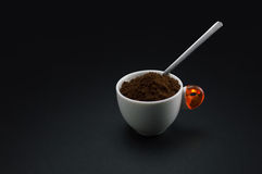 Cup of coffee. With minced coffee on black background royalty free stock photo