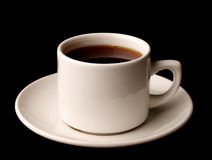 Cup of coffee. Isolated over black background Royalty Free Stock Photo