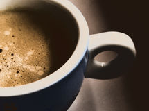 A cup of coffee. A closeup shot of a highly-contrasted simple cup  of coffee, different from usual still-life photos Stock Photography