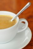 A cup of coffee. Newly brewed and stirred Stock Image