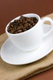 Cup with coffee. White cup up with coffee beans Royalty Free Stock Images