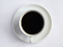 Cup of coffee. The cup of the black coffee on the white saucer. A view from the top Stock Photos