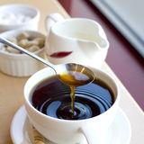 Cup of Coffee. Coffee dripping from a spoon into cup Royalty Free Stock Images