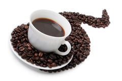The cup of coffee. In coffee beans isolated at the white background Stock Image
