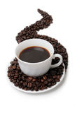 The cup of coffee. In coffee beans isolated at the white background Royalty Free Stock Photo