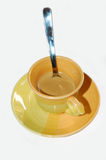 Cup of coffee. A coffee cup with teaspoon royalty free stock photos