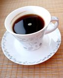 Cup of coffee. Cup of black coffee on bamboo mat stock photography