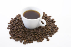 Cup of coffee. A cup of coffee sitting on coffee bean Royalty Free Stock Photography